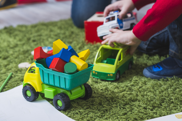 kid-playing-with-toy-cars_23-2147797995
